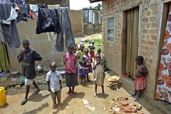 Playing Ugandan children in a slum in Kampala. Uganda, Kampala city: the atmosphere of kids, boys and girls, in their poor living environment and living Royalty Free Stock Photography