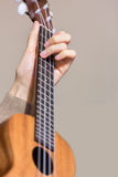Playing a ukelele Royalty Free Stock Photos