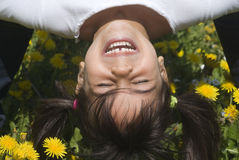 Playing upside down Stock Images