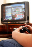 Playing video console game. On TV Stock Photography