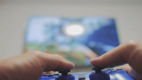 Playing video console on tv. Hand hold new joystick playing video console on tv . Gamer play game with gamepad. Controller. Gaming man holding simulator joypad stock footage