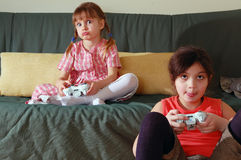 Playing Video Game. Two exited little girls playing a video game Stock Photography