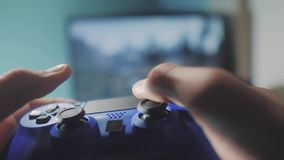 Playing video game console on tv. Hand hold new joystick online video console on tv. Gamer play game with gamepad. Controller. Gaming man holding simulator stock footage