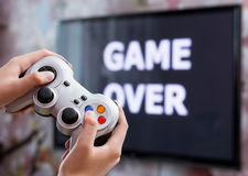 Playing video game with controller in hands Stock Photos