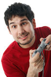 Playing video games. Man holding a game controller, isolated on white Stock Photo