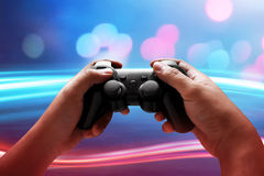 Playing video games. Gamer hobby playing video games Stock Images