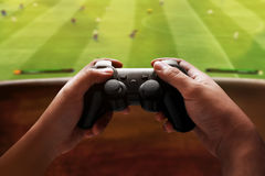 Playing video games. At home Royalty Free Stock Photography