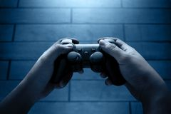 Playing video games at night Royalty Free Stock Image