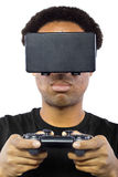 Playing Video Games with Virtual Reality Headset Stock Photo
