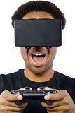 Playing Video Games with Virtual Reality Headset Royalty Free Stock Images