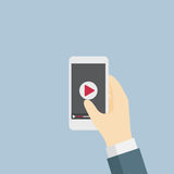 Playing Video On Mobile Phone. Businessman holding a mobile phone and going to watch video Stock Images