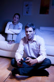 Playing Videogame. Man playing videogames, woman disappointed and bored Stock Images