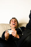 Playing videogames Stock Image