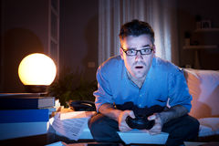 Playing videogames late at night Stock Photos