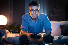 Playing videogames late at night Royalty Free Stock Photography