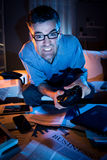 Playing videogames late at night Royalty Free Stock Images