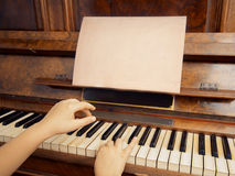 Playing on vintage piano Royalty Free Stock Photography