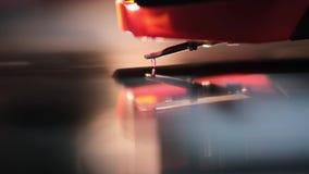 Playing vinyl music macro. Diamond stylus playing vinyl disk, macro with shallow depth of field stock footage