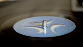 Playing a vinyl record player stock video
