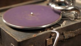 Playing vinyl records on a retro gramophone, potefone. Close-up. Men`s hands put a vinyl record and start a gramophone. HD stock video footage