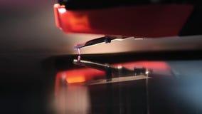 Vinyl playing macro. Playing vinyl turntable macro with reflection, focus on stylus stock video
