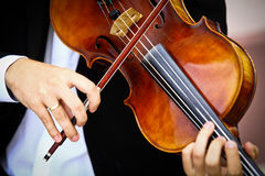 Playing viola. Detail of viola being played by a musician Stock Photo
