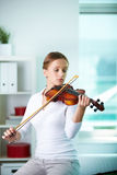 Playing the violin Royalty Free Stock Image