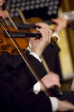 Playing violin. A night at the symphony concert - playing violins stock photos