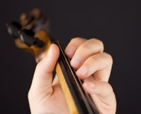 Playing violin Stock Images