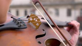 Playing the violin close up. The strings on which the fiddlestick moves very quickly. Virtuoso playing an music stock footage