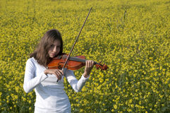 Playing violin girl Stock Photo