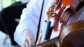 Playing the violin in the orchestra stock video footage