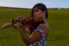 Playing violin in the park Stock Images