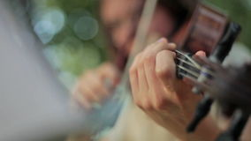 Playing violin stock footage