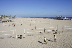 Playing Volley Ball at the Beach. A group of people were playing Volley Ball at the Beach under the heat of the sun Royalty Free Stock Photo