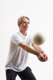 Playing volleyball. One man in a white shirt is playing volleyball Stock Photos