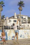 Playing Volleyball on beach, Royalty Free Stock Images