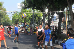 Playing volleyball in the streets Stock Photos