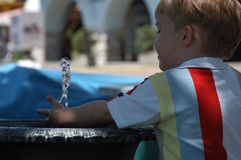 Playing with water. Young boy at a fountain Stock Image