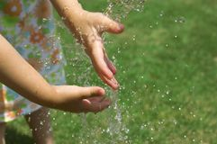 Playing with water. Children hands and water royalty free stock images
