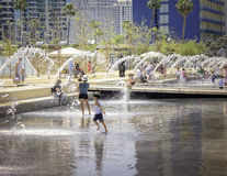 Playing in a Water Fountain, California Stock Images