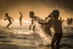 Playing at the water. Rio de Janeiro, Brasil. Playing at the water. The Sunset and the gold hour. Rio de Janeiro, Brasil royalty free stock photos