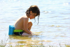 Playing in the water. Small boy playing in a freshwater lake Royalty Free Stock Photography