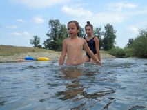 Playing in the water. Tow girls playing in the water of a river Royalty Free Stock Photo
