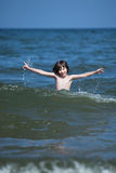 Playing in wather. Boy playing in wather, in the sea Royalty Free Stock Images