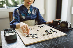 Playing wei qi game Stock Image