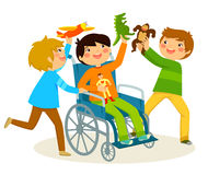 Playing in a wheelchair. Boy in wheelchair playing with his friends Royalty Free Stock Photos