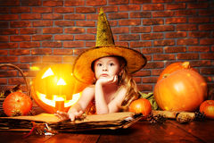Playing in a witch Stock Image