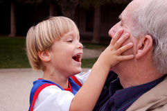 Playing With Grandpa Royalty Free Stock Photos