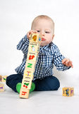 Playing with wooden blocks Royalty Free Stock Photography